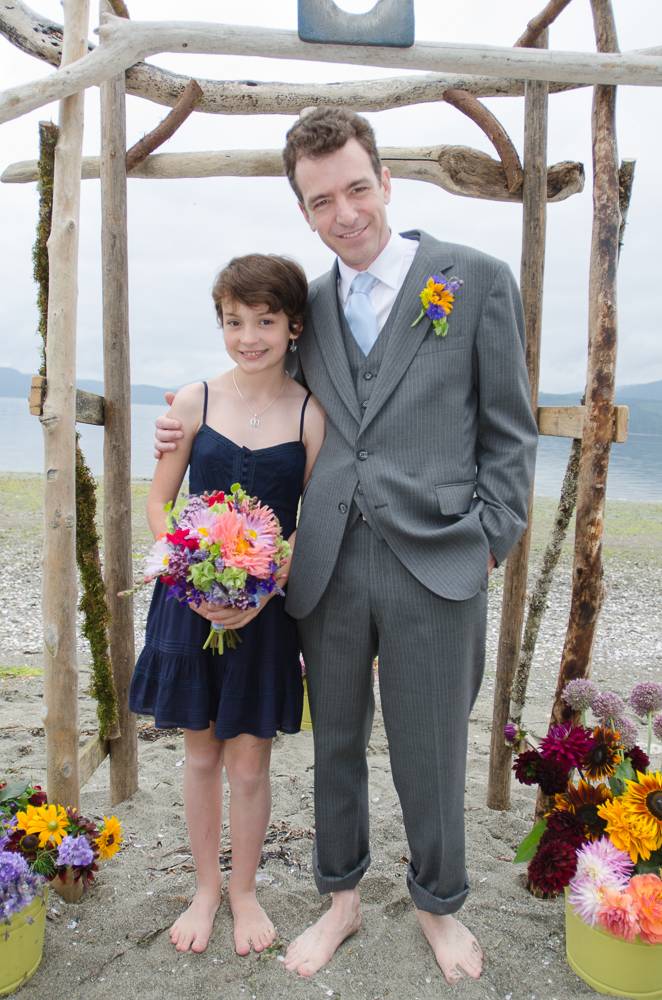Groom and step-daughter at the beach